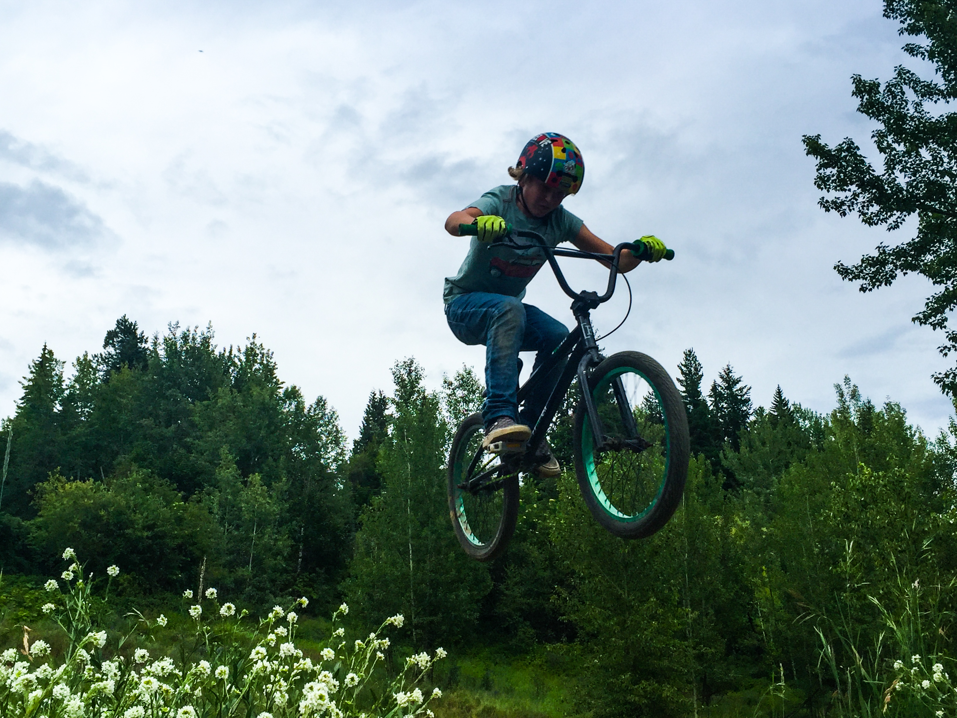 Up and over the table top. Rossland, BC bike park.